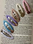 Ribbon covered snap clips. x 2